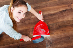 Cleaning woman sweeping wooden floor Royalty Free Stock Photos