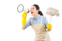 Cleaning woman washing floor with mop. And holding loud speaker calling everybody during spring cleaning. Multicultural Chinese Asian housewife isolated on Royalty Free Stock Photos