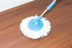 Cleaning wood floor by modern mop. Royalty Free Stock Photos