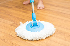 Cleaning wood floor by modern mop. Royalty Free Stock Photo