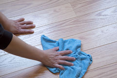 Cleaning wood flooring stock image
