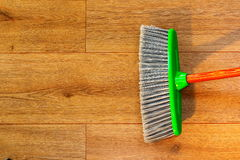 Cleaning wooden floor with broom Stock Photography