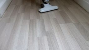Cleaning wooden floor stock video footage