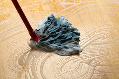 Cleaning wooden floor Stock Image
