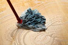 Cleaning wooden floor Stock Image