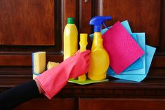 Cleaning wooden furniture. Indoor cleaning. Royalty Free Stock Photos