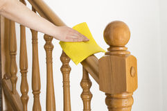 Cleaning wooden railing Stock Photo