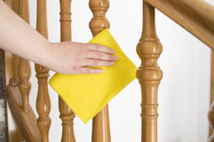 Cleaning wooden railing Royalty Free Stock Images