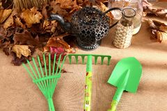 When the spring or autumn season comes, it`s time to organize the garden. During cleaning works, various garden tools are useful which shorten the working time Royalty Free Stock Photo