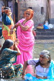 Indian woman. Women cleansing themselves in the water of a holy river in India Royalty Free Stock Photos
