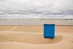 Cleanness on the beach. Trash box on the beach at the sea under cloudy sky Stock Images