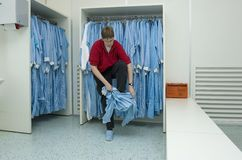 Cleanroom clothing. Putting on cleanroom clothes in the right manner Fourth step stock images