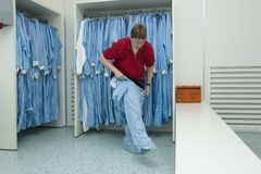 Cleanroom clothing. Putting on cleanroom clothes in the right manner Fifth step royalty free stock images