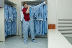 Cleanroom clothing. Putting on cleanroom clothes in the right manner Sixth step stock images