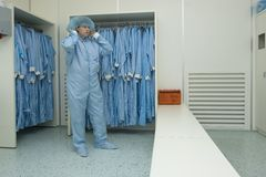 Cleanroom clothing. Putting on cleanroom clothes in the right manner Ninth step stock image