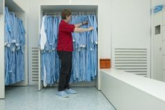 Cleanroom clothing III. Putting on cleanroom clothes in the right manner Stock Photos