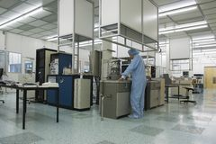Cleanroom III. Work in the controlled environment of a high tech research cleanroom stock photos