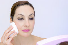 Cleansing the face of makeup Stock Photography