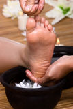 Cleansing in foot reflexology. The foot is being cleansed after massage Royalty Free Stock Photo