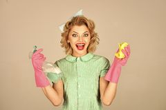 Cleanup, cleaning services. Pinup woman hold soup bottle, duster. royalty free stock image