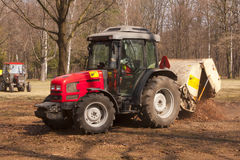 Cleanup at the park by tractor Stock Image