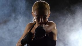 Clear accurate punches towards the camera makes the girl boxer stock video