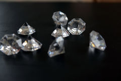 Clear Acrylic Diamonds. On black close-up Stock Image