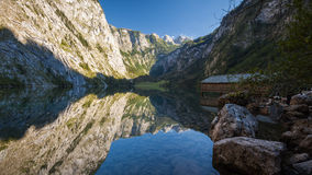 Clear Alpine Mountain Lake with Reflection Royalty Free Stock Images