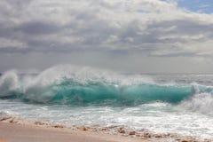 Clear Aqua Wave. A big wave hits Banzai Pipeline on the North shore of Oahu Stock Photo