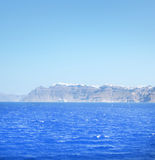 Clear azure sea in Greece and island with mountains on the backg Royalty Free Stock Photos