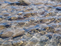 Clear background. Stones under the water stock photography