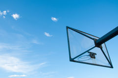 Clear basketball board outside an open sky Stock Photo