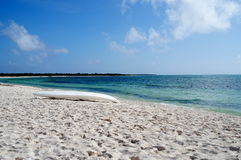 Clear Beach. Paddle boat on a beach with white sand and blue water Stock Photography
