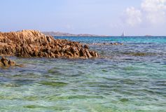 Clear beautiful azure coloured sea water with granite rocks, Sardinia beach Italy royalty free stock images