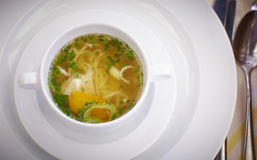 Clear beef broth with noodles and vegetables Royalty Free Stock Photo