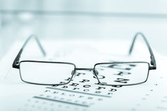 Clear Black modern glasses on a eye sight test Royalty Free Stock Images