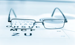 Clear Black modern glasses on a eye sight test Royalty Free Stock Image