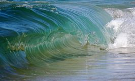 Clear Blue Barreling Surf Stock Images