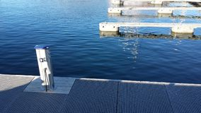 Clear blue fjord under empty dock. In summer sunshine stock photos