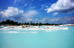 Clear blue Kaolin Lake, Belitung Island in Air Raya Village. Man-made artificial lake Kaolin, turned from a mining ground holes. Land contains kaolinite and is Stock Photos