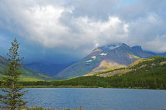 Clear blue lake in Glacier National Park. Stock Photos