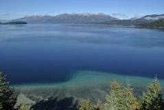 Most beautiful lake perfectly blue. Driving the seven lake route from Bariloche through breathtaking nature. This is one of the many beautiful lakes stock photography