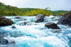 Clear blue mountain river Royalty Free Stock Images