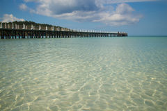 Clear, Blue Ocean Water and Dock Royalty Free Stock Photos