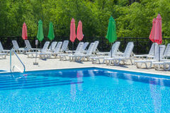Clear Blue Pool. With Sun Loungers Stock Image