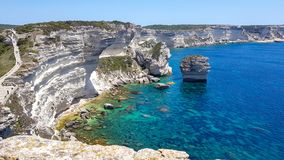 Clear blue sea and cliffs of Corsica stock photography