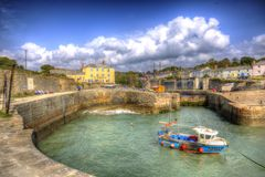 Clear blue sea in the Cornish harbour of Charlestown near St Austell Cornwall England UK in HDR. Charlestown near St Austell Cornwall England UK Cornish fishing Royalty Free Stock Image