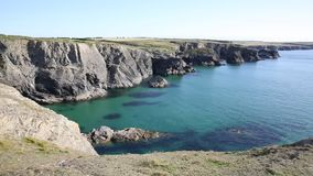 Clear blue sea on the English coast in North Cornwall between Treyarnon and Porthcothan in summer stock video