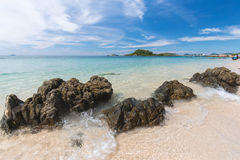 Clear blue sea and moving wave on beach rock beach Stock Image