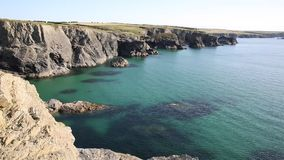 Clear blue sea on the UK coast in North Cornwall between Treyarnon and Porthcothan in summer. From the south west coastal path stock footage